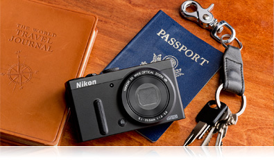 Photo of the Nikon COOLPIX P330, a passport, keys and journal