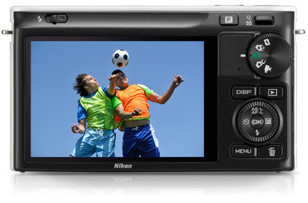 Rear of the Nikon 1 J2 showing its 3-inch LCD and soccer players on the screen