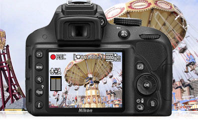 Photo of the rear of the D3300 with a scene from an amusement park on the LCD showing video recording