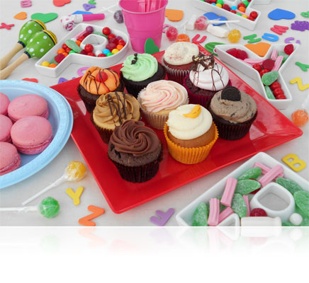 Photo of a tray of cupcakes and party candy