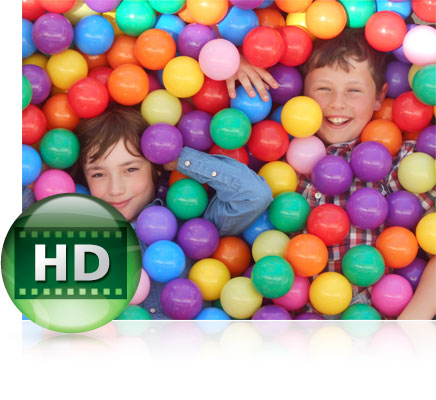 Photo of two boys playing in a ball pit