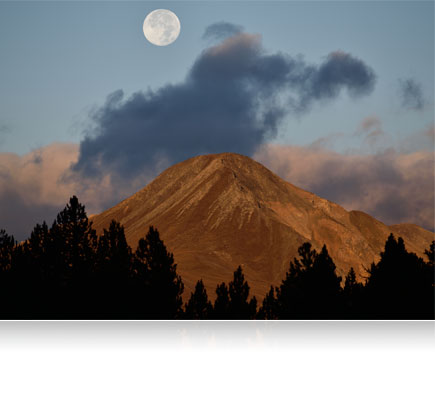 Photo of a mountain with the full moon in the sky shot using the AF-S NIKKOR 300mm f/4E PF ED VR lens