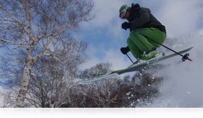 Photo of a skiier jumping in air over snow highlighting Motion Detection