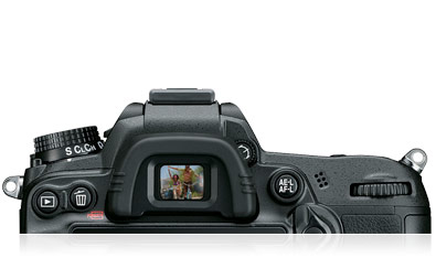 Top rear of the Nikon D7000 body, shown from the rear of the body, including an illustrative image in the viewfinder