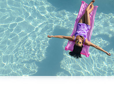 Nikon D7000 photo of a girl on a pool float, in a pool, shot from above, and an inset image of the CMOS sensor