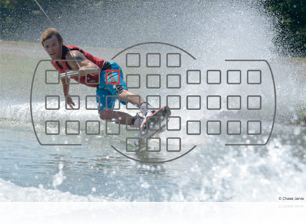 Nikon D7000 photo of a guy on a slalom waterski, with an overlay of the camera's AF points illustrating the AF system.