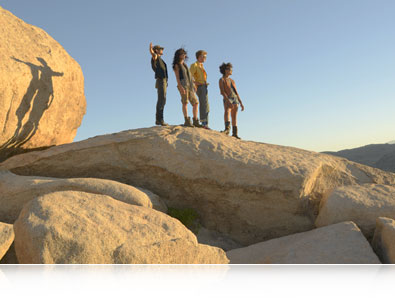 Nikon D7000 photo of four young adults on a large boulder in the mountains and inset photo of the camera's image processing engine