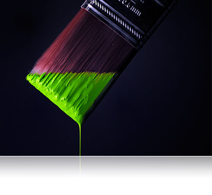 Photo of a paintbrush with bright green paint dripping off the edge, lit with Nikon Speedlights