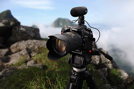 Photo of a Nikon D7100 and ME-E mic on a tripod, on a mountaintop